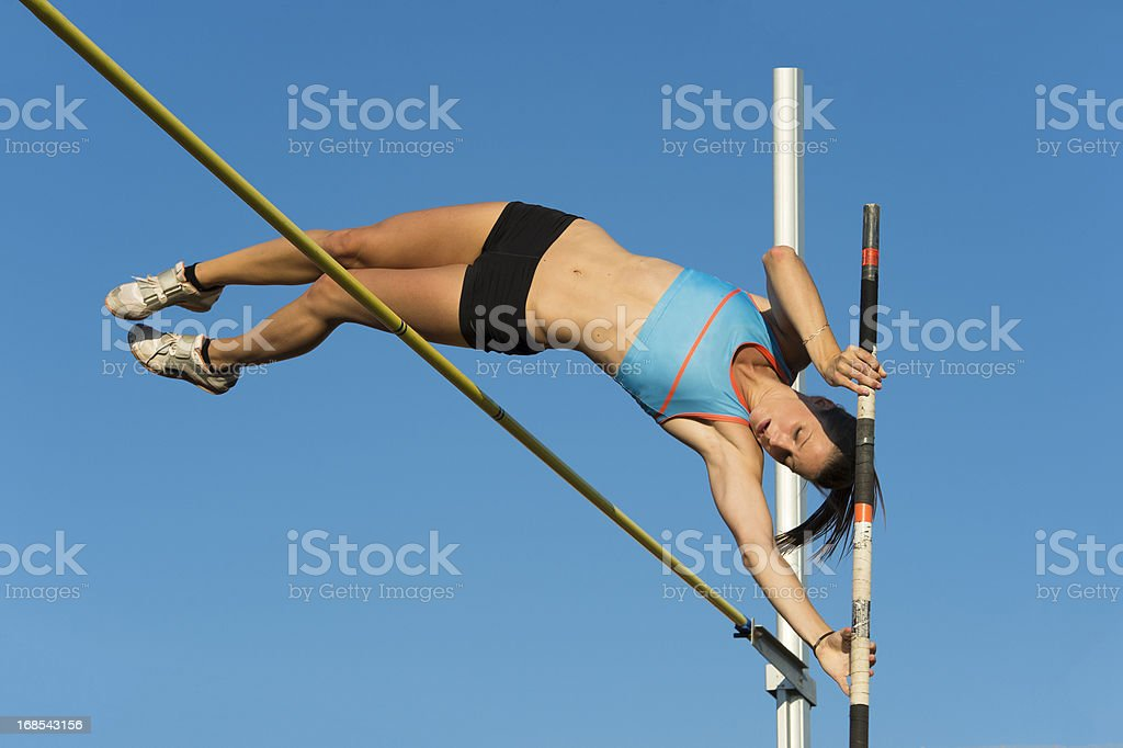 Beautiful young women jumping over the lath stock photo