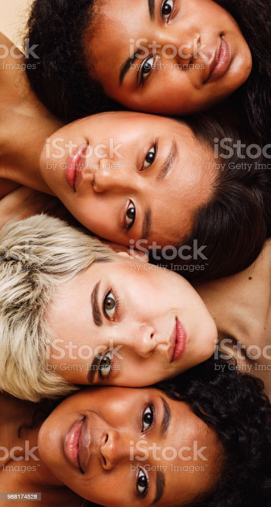 Beautiful young women lying on top of each other, looking at camera foto stock royalty-free