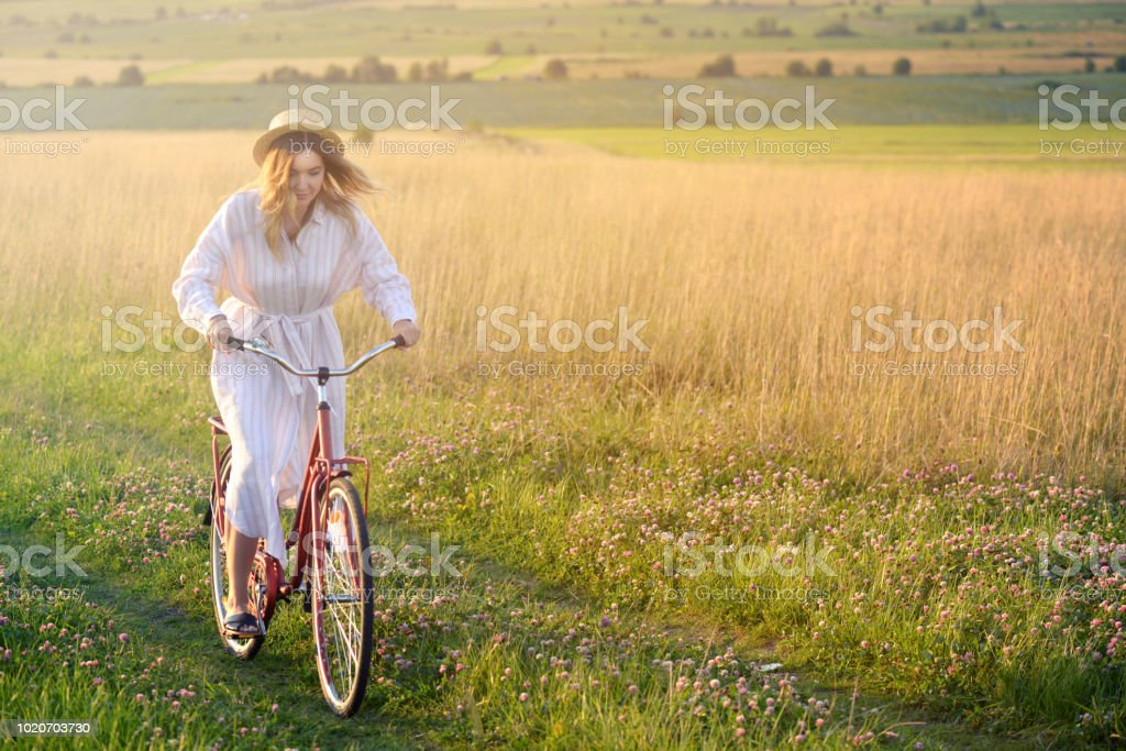 Beautiful young women on the nature( bicycle) royalty-free stock photo