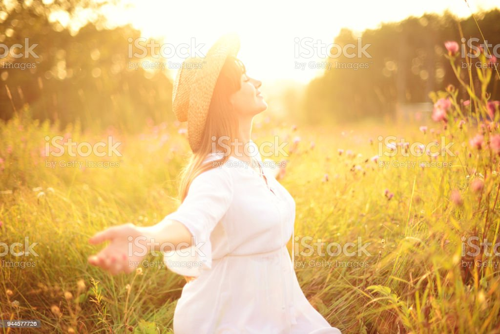 Beautiful young women on the nature stock photo