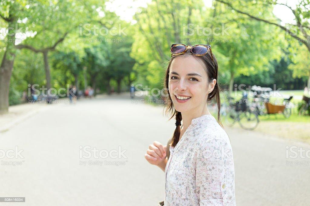 Beautiful young women smiling outdoors stock photo
