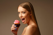 Beautiful young women, with cupcakes. Enjoying the little things in life.  Blonde, blue eyes, long hair
