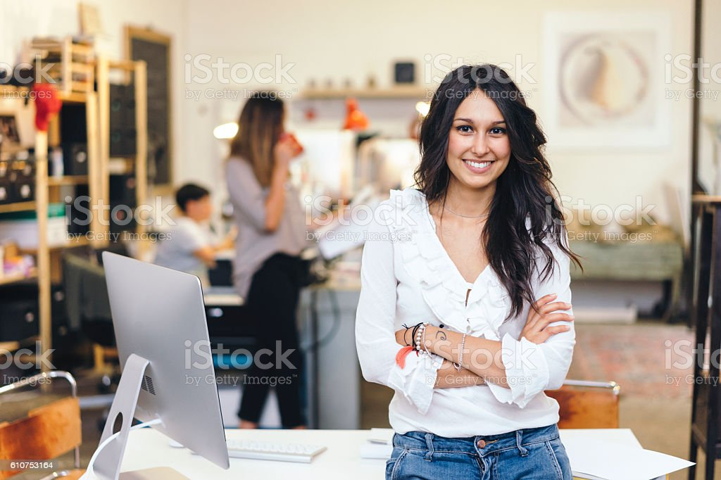 Beautiful Young Women Working Together In A Startup stock photo
