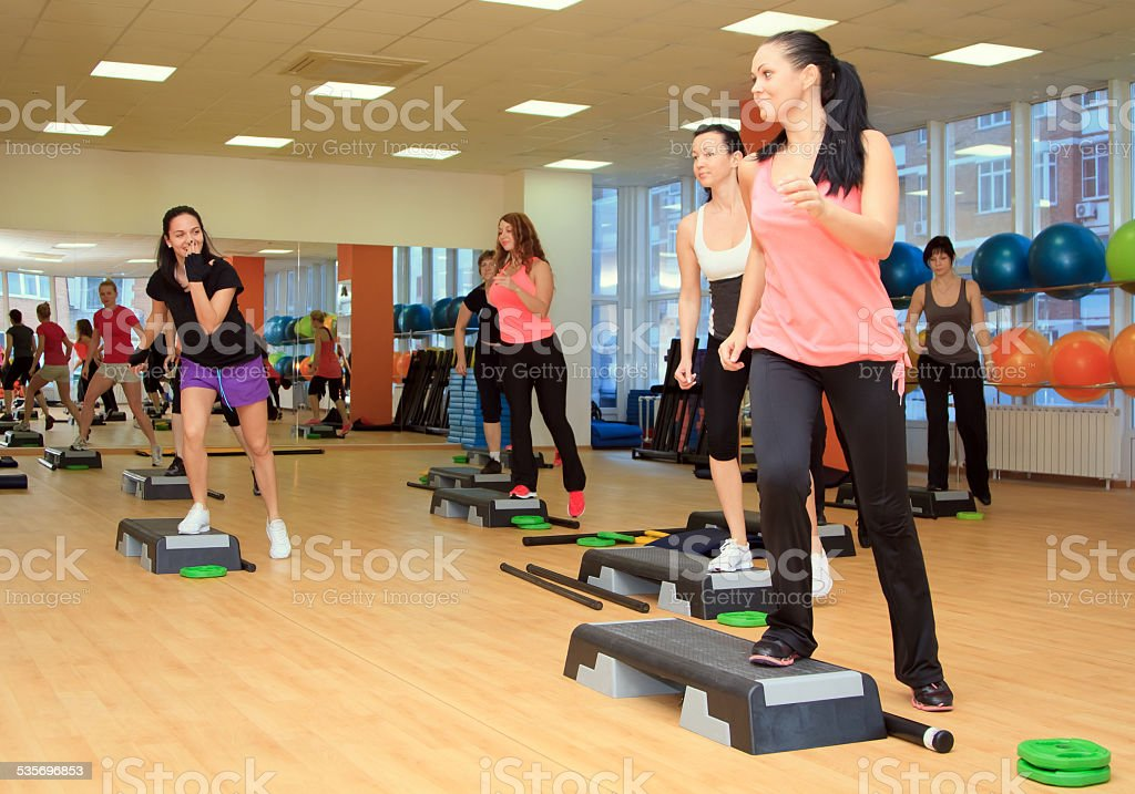 Beautifull female on the step board during exercise stock photo