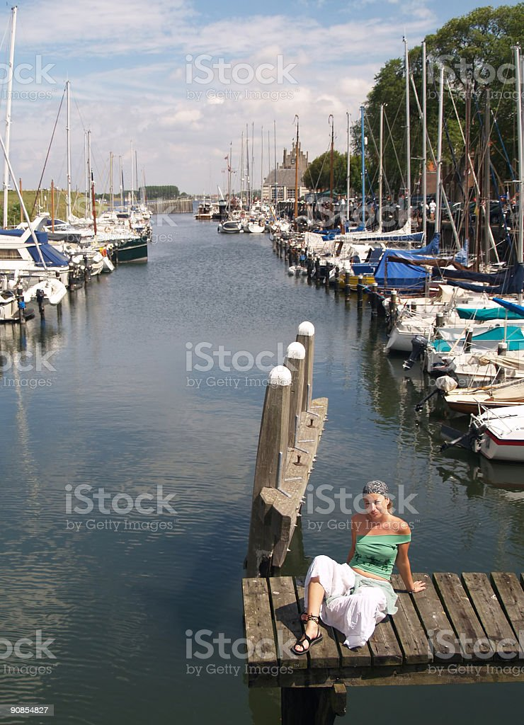 Beautifull girl and Yachts docked in Veere, Zeeland. royalty-free stock photo