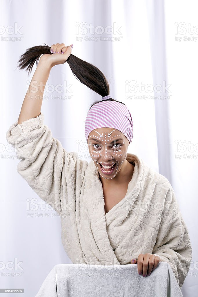 Beautifull girl in the spa center pulling her hair royalty-free stock photo