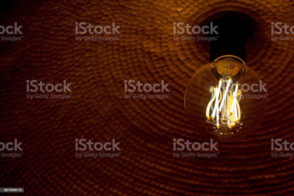 Beautifull ornamental light bulbs creating classic rustic look and glow stock photo