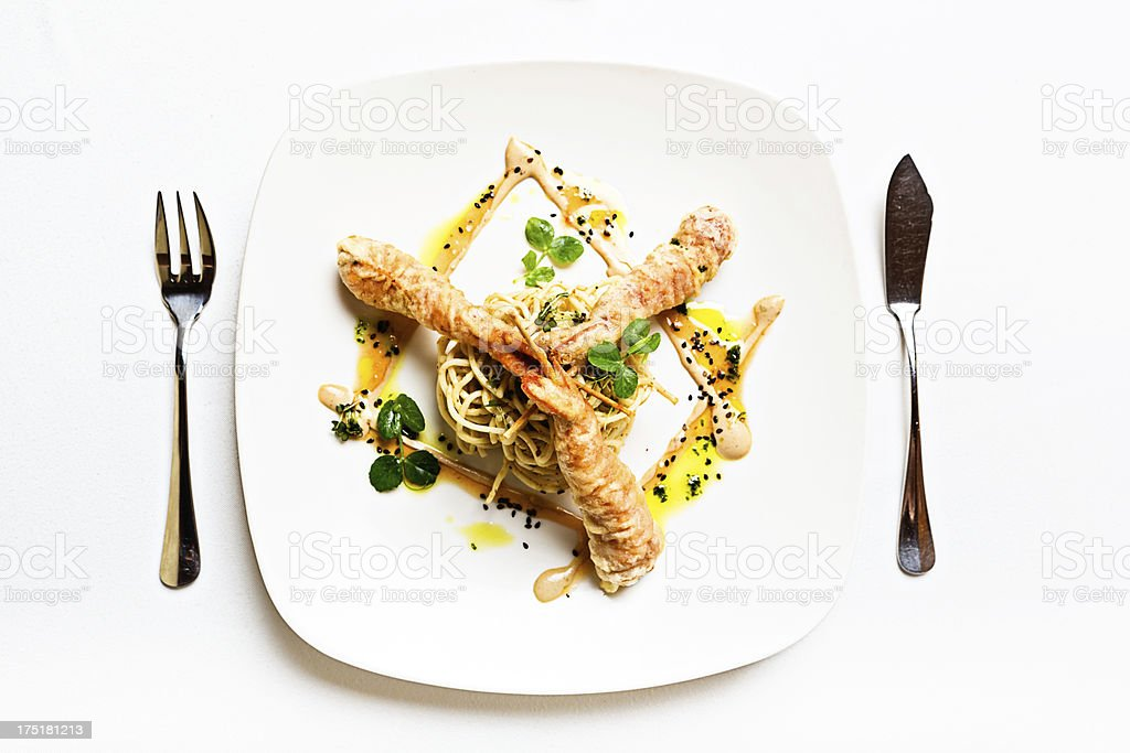 Beautifully arranged restaurant appetizer of tempura-style prawns stock photo
