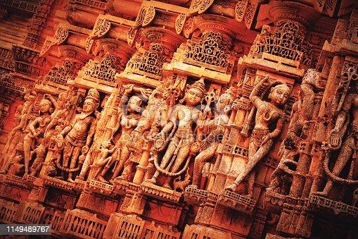 istock Beautifully carved idols on the wall of shrine jain temple of palitana, gujarat, india. 1149489767
