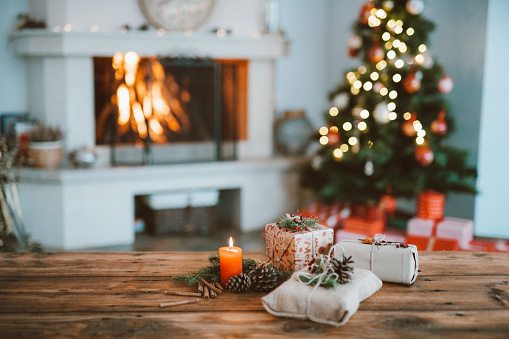 Beautifully decorated home for Christmas with a Christmas tree , candles and Christmas gifts