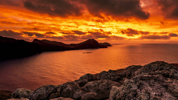 Beautifully colored Sunrise on Madeira coastline stock photo