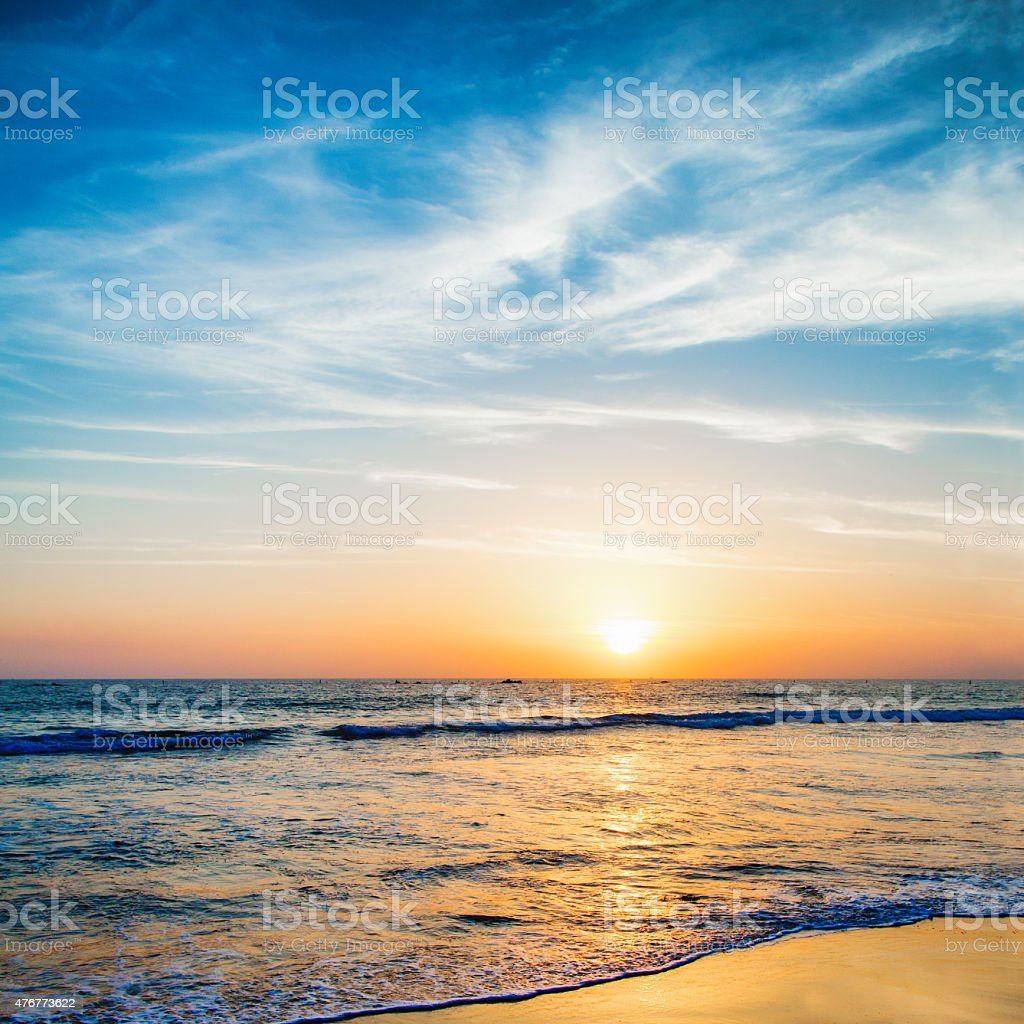 Beautifully colored sunset over pacific ocean Santa monica beach stock photo