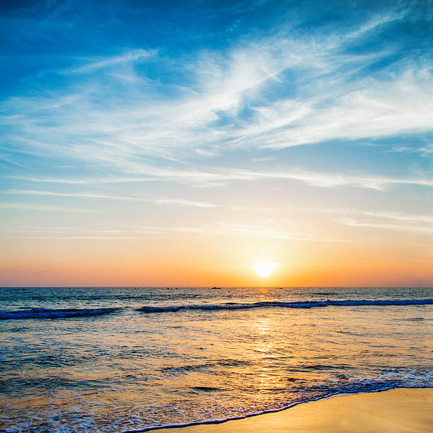 beautifully colored sunset over pacific ocean santa monica beach - saturated color stock pictures, royalty-free photos & images