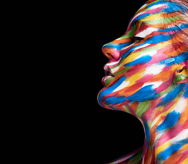 Beautifully coloured Cropped shot of a young woman posing with paint on her face body paint stock pictures, royalty-free photos & images