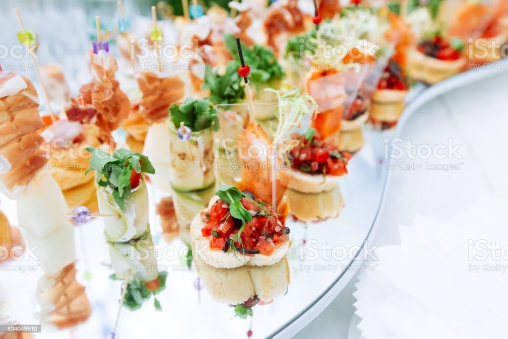 Beautifully decorated catering banquet table with different food snacks and appetizers - foto stock