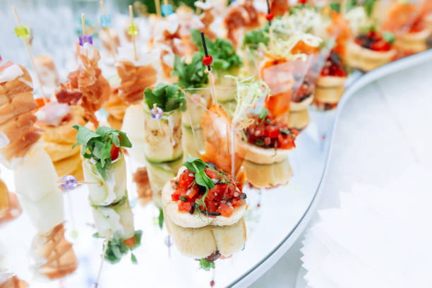 Beautifully decorated catering banquet table with different food snacks and appetizers stock photo