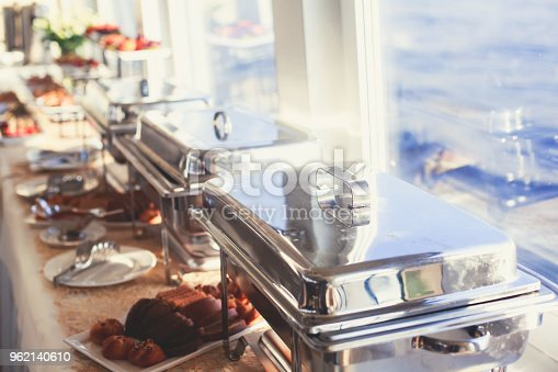 istock Beautifully decorated catering banquet table with different food snacks and appetizers on corporate christmas birthday party event or wedding celebration 962140610