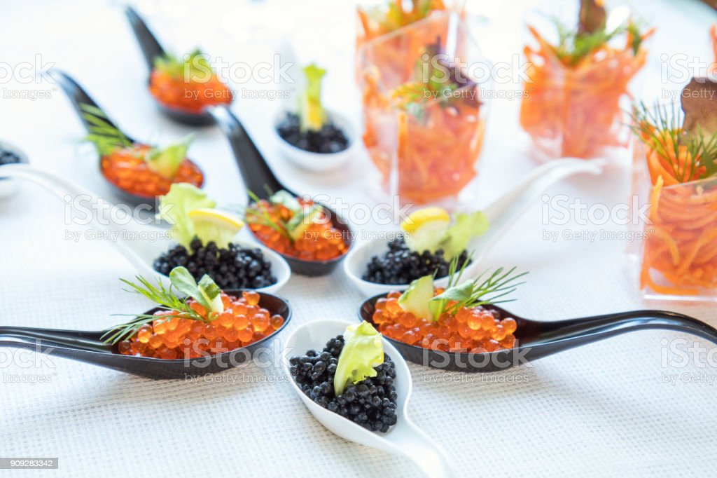 Beautifully decorated catering banquet table with different food salad, caviar on corporate christmas birthday party event or wedding celebration royalty-free stock photo