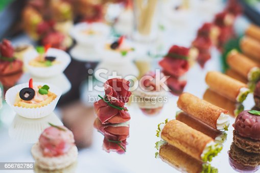 istock Beautifully decorated catering banquet table with different food snacks 656762786