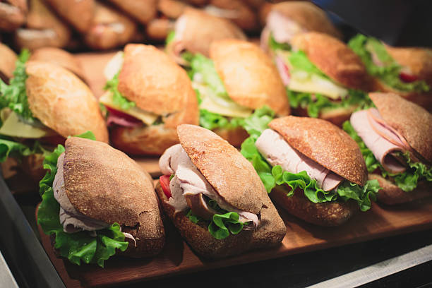 beautifully decorated catering banquet table with sandwiches - bocadillo fotografías e imágenes de stock