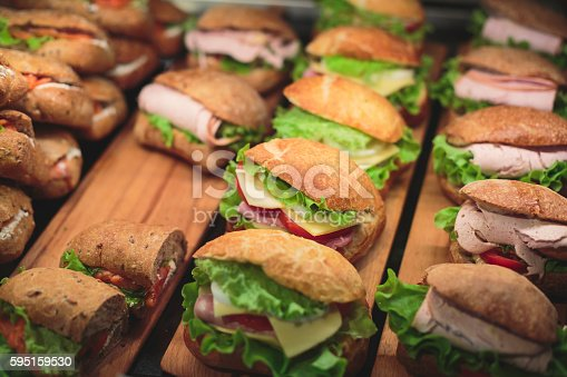 istock Beautifully decorated catering banquet table with sandwiches 595159530