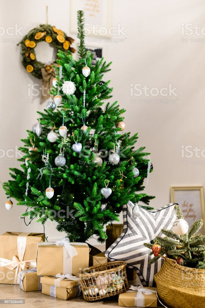 Beautifully Decorated Christmas Tree With Presents Under It In T