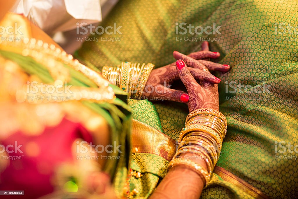 beautifully decorated Indian bride hands stock photo