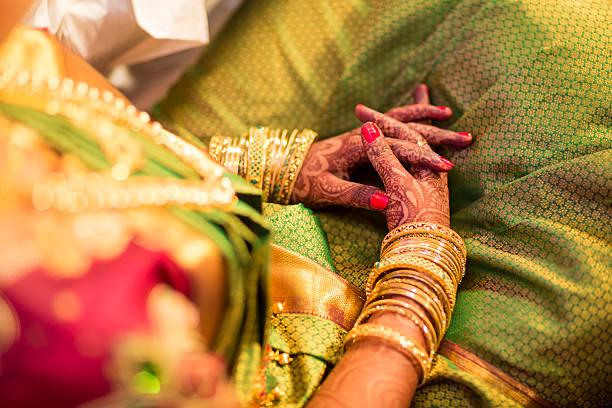 beautifully decorated indian bride hands - hand gold jewels bildbanksfoton och bilder