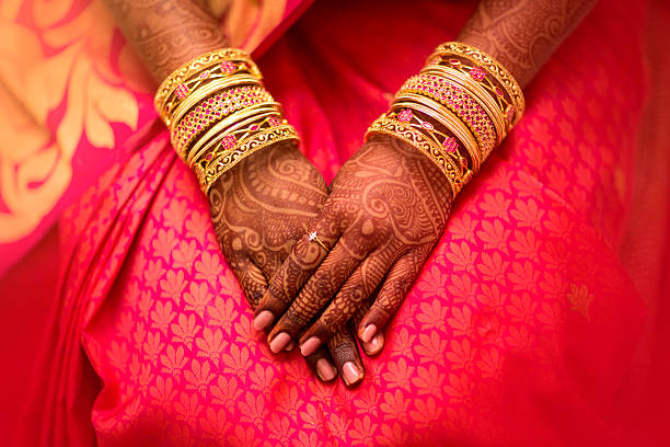 beautifully decorated indian bride hands. - hinduism stock photos and pictures
