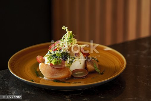 Beautifully decorated plate of burrata