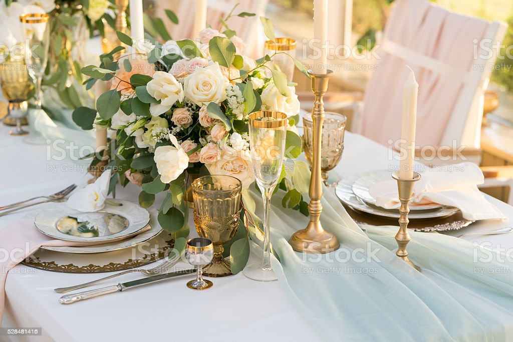 beautifully decorated table with flowers stock photo