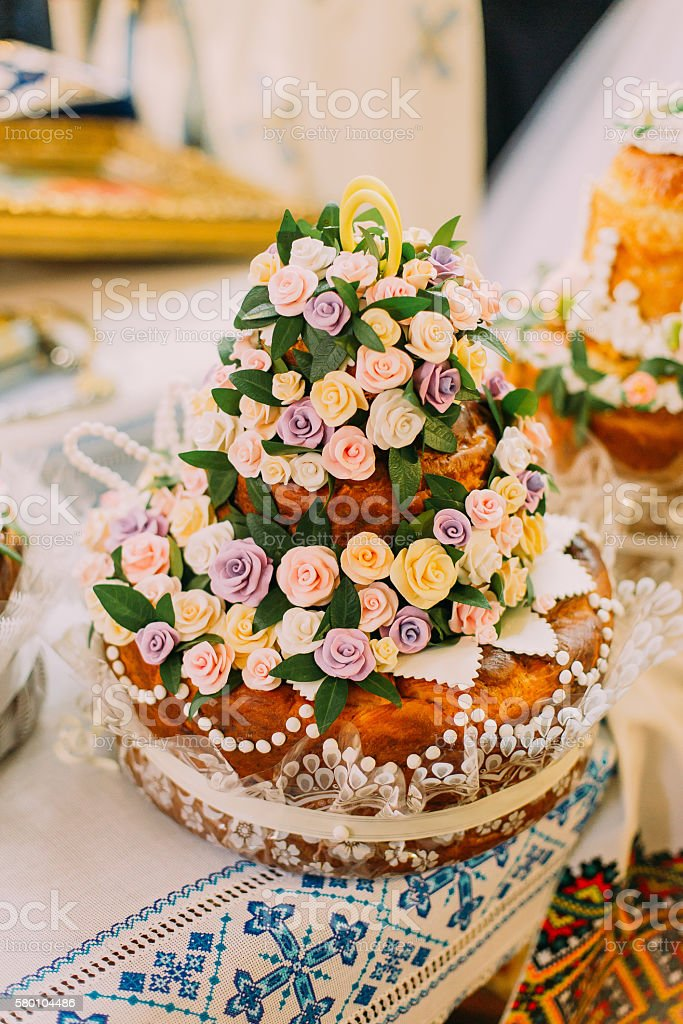 Beautifully decorated traditional wedding bread on altar in easter european stock photo