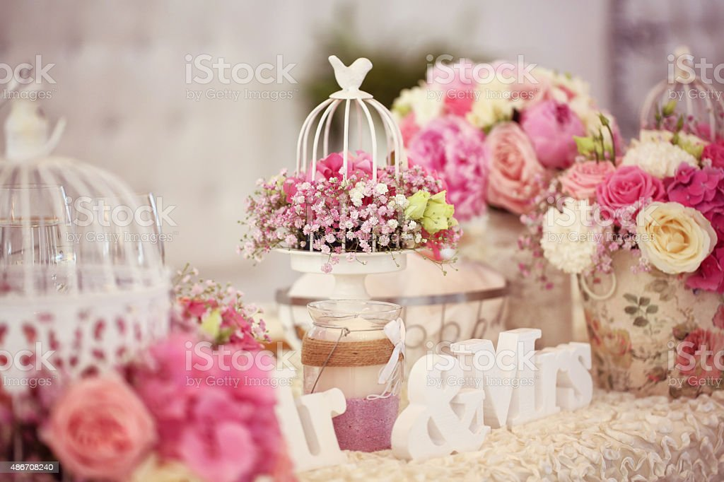 Beautifully decorated wedding table with flowers stock photo
