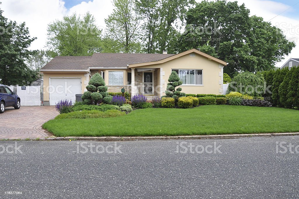 Beautifully Landscaped Ranch Style Suburban Home stock photo