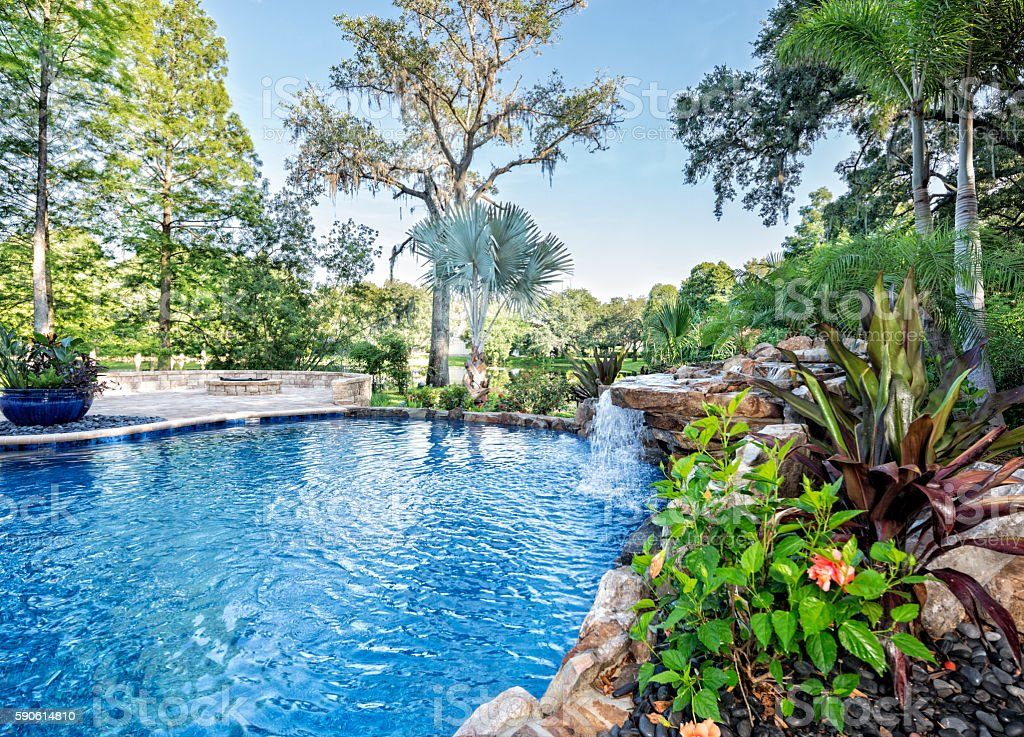 A beautiful landscaped swimming pool at an estate home overlooking a...