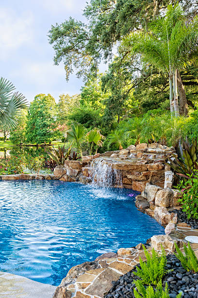 Beautifully Landscaped Swimming Pool at Estate Home stock photo