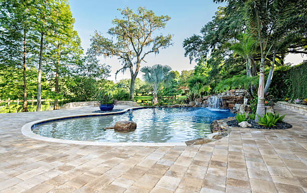 Beautifully Landscaped Swimming Pool with Waterfall at Estate Home stock photo