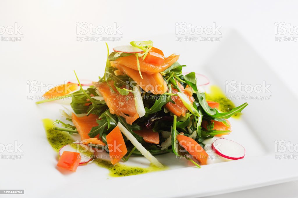 Beautifully presented salmon salad at a top restaurant royalty-free stock photo