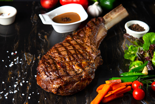 istock beautifully seared tomahawk steak, medium rare to rare 1145778080