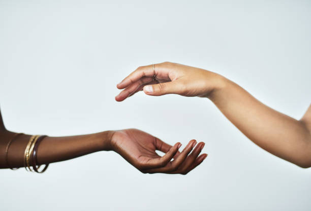 Beautifully soft hands are within your reach Cropped studio shot of two women touching hands against a gray background hand stock pictures, royalty-free photos & images