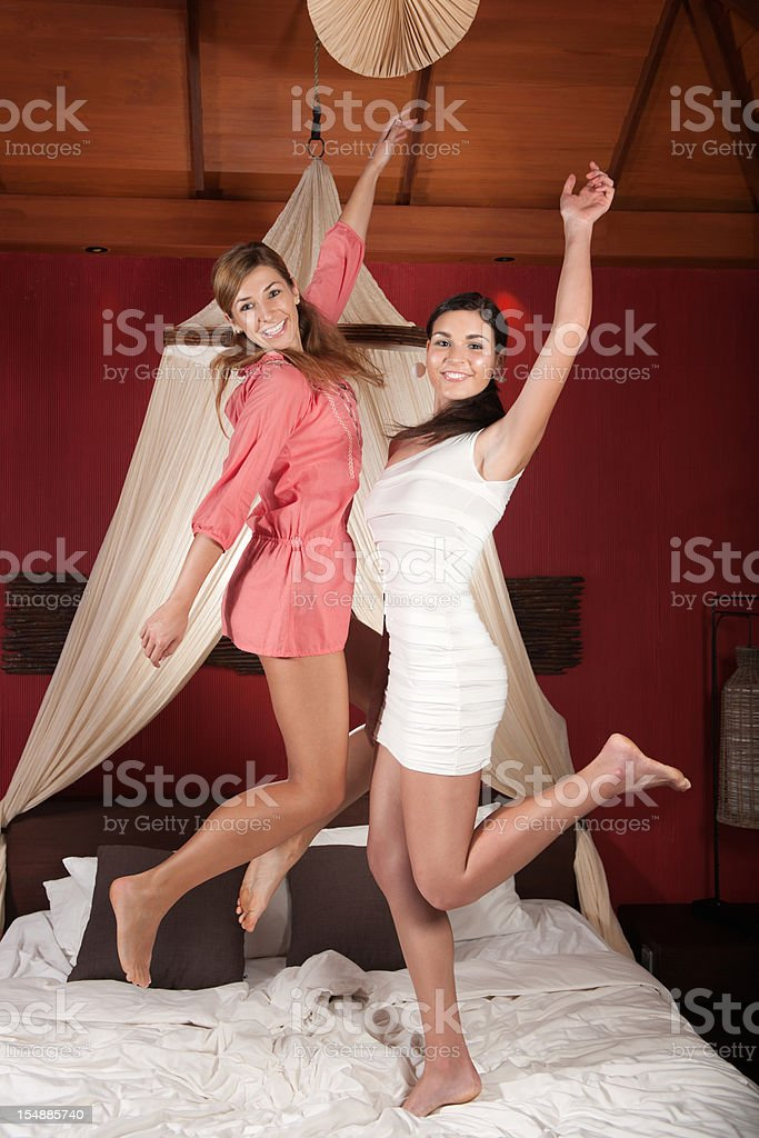 Beautifuls Girls jumping on the bed (XXXL) royalty-free stock photo