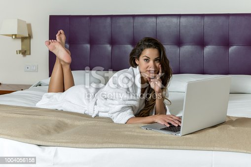 istock Beautiful?woman on bed with laptop 1004056158
