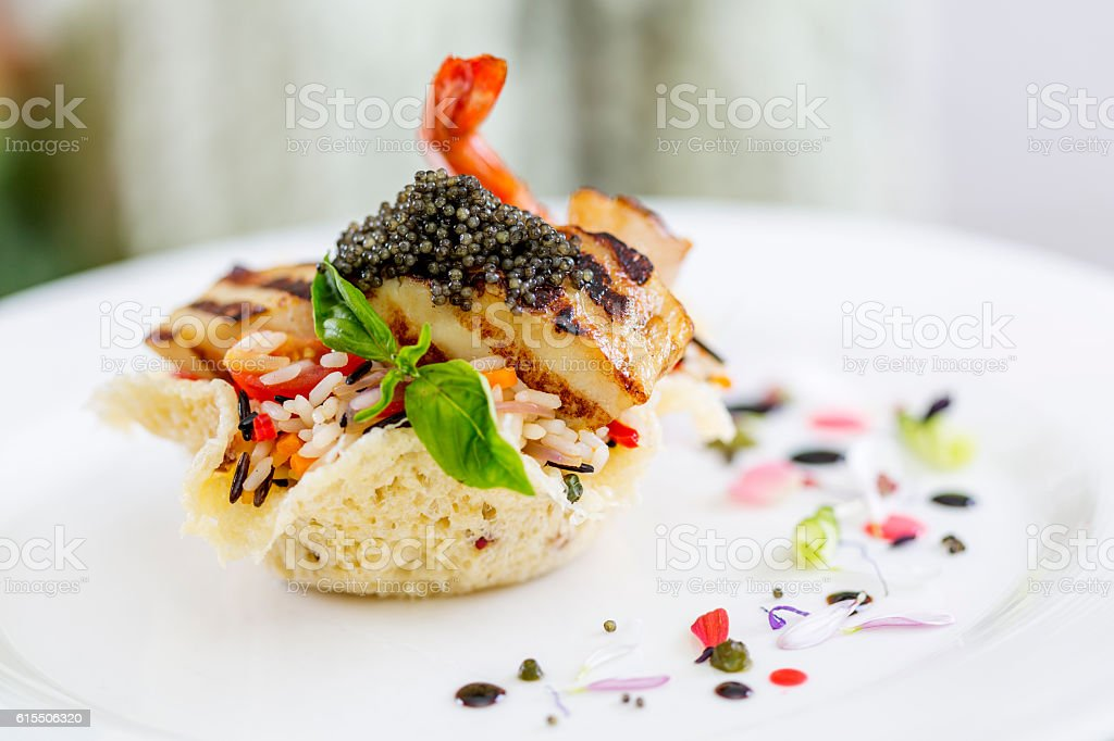 Beautifuly decorated main course in restaurant stock photo