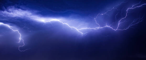 beautiul and dramatic lightning in sky stock photo