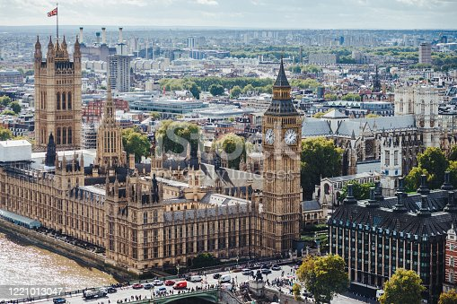 Beautiul outdoor view of Big Ben and Westmisnter bridge in London. Busy city. Horizontal shot of wonderful historical monuments. Sightseeing and tourism concept.