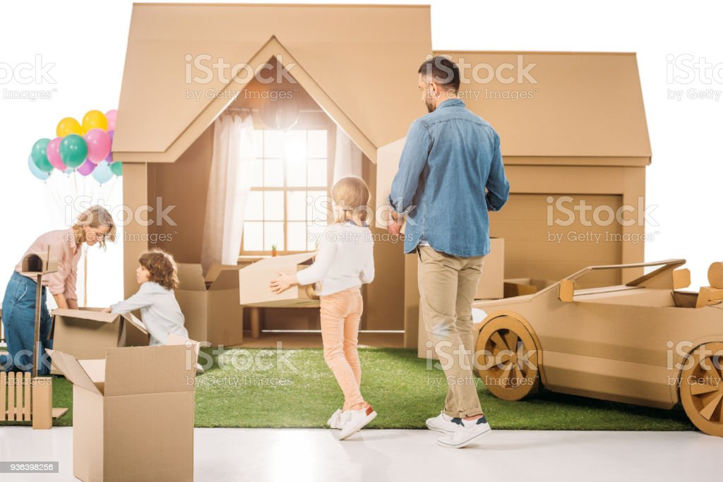 Beautiul Young Family Moving Into New Cardboard House