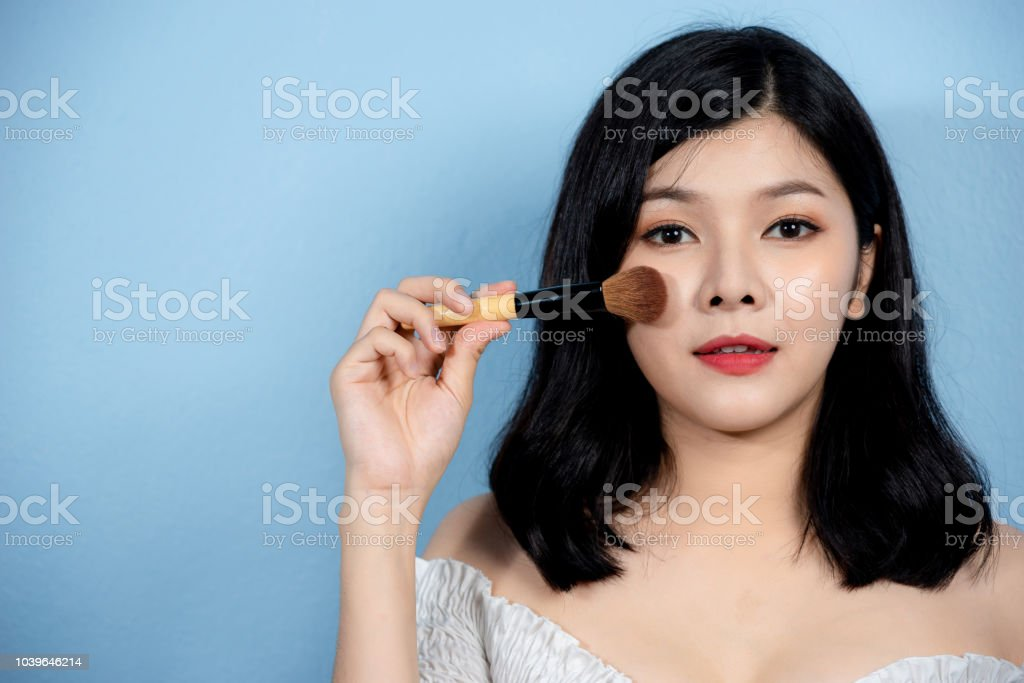 Beauty and cosmetic concept. Beauty Asian woman and makeup brush....