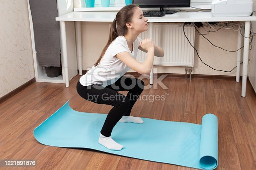 925799546 istock photo Beauty and health at home during a pandemic quarantine. Girl do online exercises by video calling 1221891876