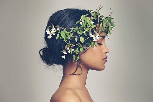 Studio shot of a beautiful young woman wearing a head wreath