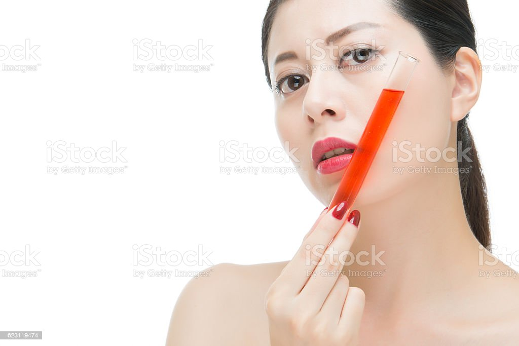 Beauty Asian Woman Red Lips Nail And Holding Chemistry Tube Royalty Free Stock Photo